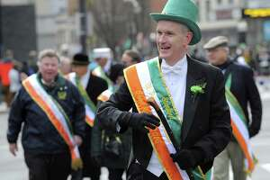 Connecticut Supreme Court Justice Andrew McDonald marches down Bedford Street during the annual St Patrick's Day parade in Stamford, Conn. on March 5, 2016. McDonald was the 2016 Grand Marshal for the event.