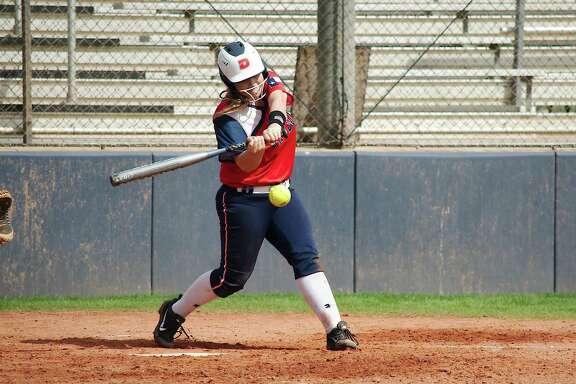 Dawson's Katelyn Day (3) bats against Tompkins Friday, Feb. 23 at Dawson High School.