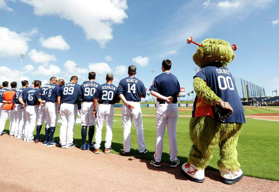 Orbit and the Houston Astros line up for the National Anthem before the start of the Astros Braves spring training game at The Fitteam Ballpark of the Palm Beaches, Saturday, Feb. 24, 2018, in West Palm Beach. Photo: Karen Warren, Houston Chronicle / © 2018 Houston Chronicle