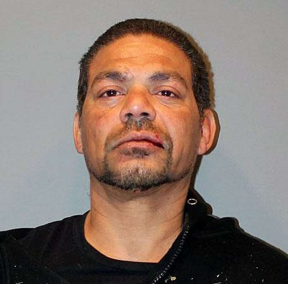 Brian Torres, 45, of Bridgeport, Conn., was charged on Feb. 24, 2018, with criminal possession of a firearm, weapons in a motor vehicle, second-degree breach of peace, first-degree threatening, third-degree intimidation based on bias and first-degree reckless endangerment. Photo: Contributed Photo / Stratford Police Department / Contributed Photo / Connecticut Post Contributed