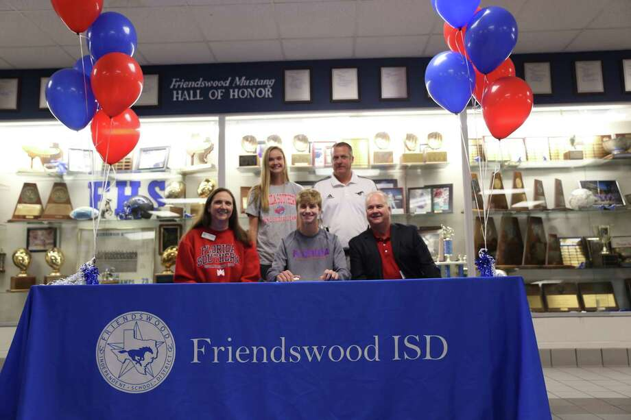 Friendswood soccer player Kyle Harner has signed a national letter of intent with Florida Southern University. Joining Harner at the signing are (front row) parents Marianne and Greg Harner and (back row) sister Bryanne Harner and Friendswood head soccer coach Stephen Peter. Photo: Submitted Photo