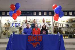 Ben Redding has signed a national football letter of intent with Southern Methodist University. Redding was joined at the signing by (front row) his parents David and Kristen Redding and (back row) grandfather Bud Barker, Friendswood coach Brian Bielamowicz and FHS athletic director Robert Koopmann.
