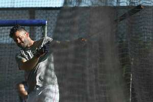 Houston Astros Jose Altuve takes an early moring batting practice in the cages during spring training at The Fitteam Ballpark of the Palm Beaches, Saturday, Feb. 24, 2018, in West Palm Beach.