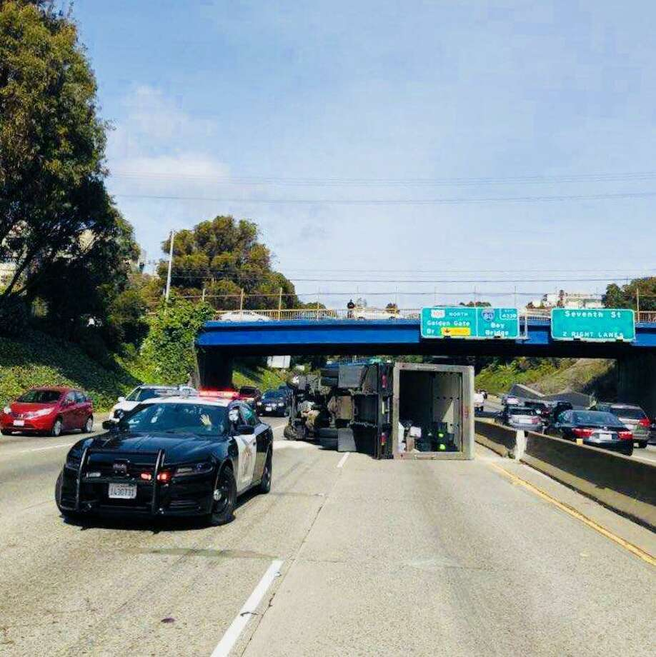 An overturned truck blocked two left lanes on southbounc US-101 near Cesar Chavez Street in San Francisco.