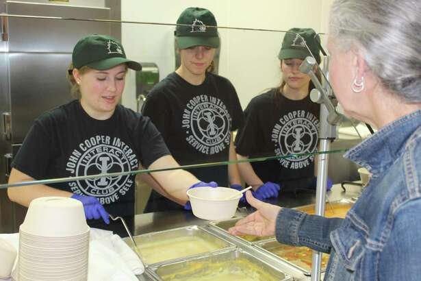 From left: Lauren Sands, Bea Portela and Katie Evans served soup to attendees at the Empty Bowls lunch at The John Cooper School on Feb. 24.