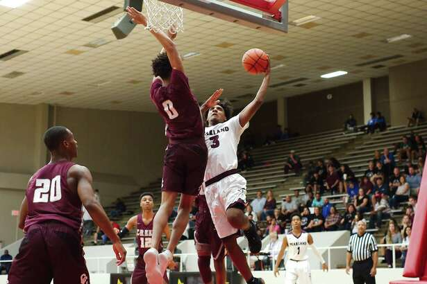 Pearland's Ovidio Perez (3) tries to put up a shot over Clear Creek's Donta Smith (0) Tuesday, Feb. 20 at Pasadena ISD Phillips Field House.