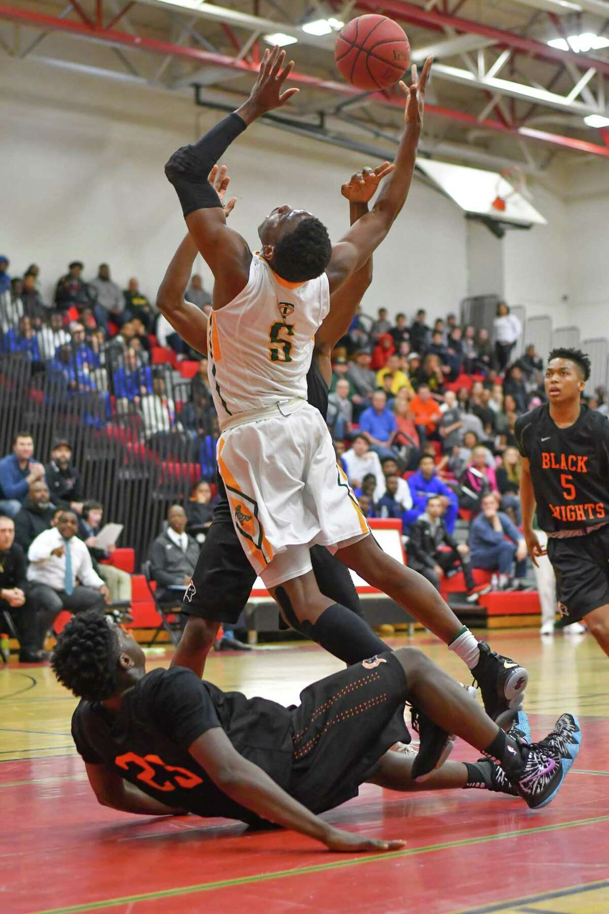 Contavio Dutreil (5) of the Trinity Catholic Crusaders goes up for a shot during a FCIAC quarter final game against the Stamford Black Knights at Fairfield Warde High School on Saturday February 24, 2018, in Fairfield, Connecticut.