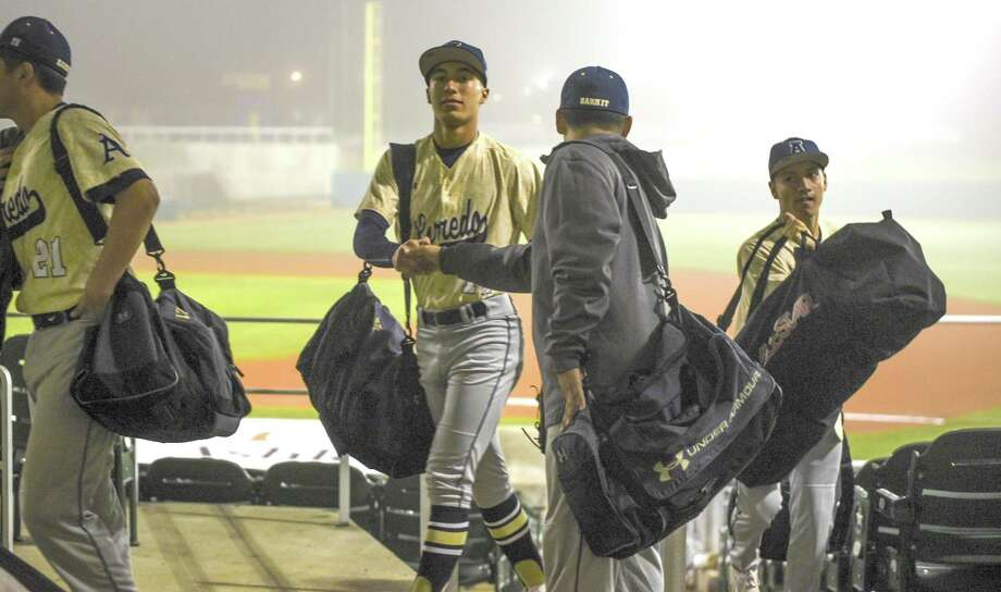 Alexander leaves Uni-Trade Stadium Friday night after its game against Tomball was postponed due to fog. The Bulldogs' first game was also postponed due to wet field conditions. Photo: Danny Zaragoza /Laredo Morning Times