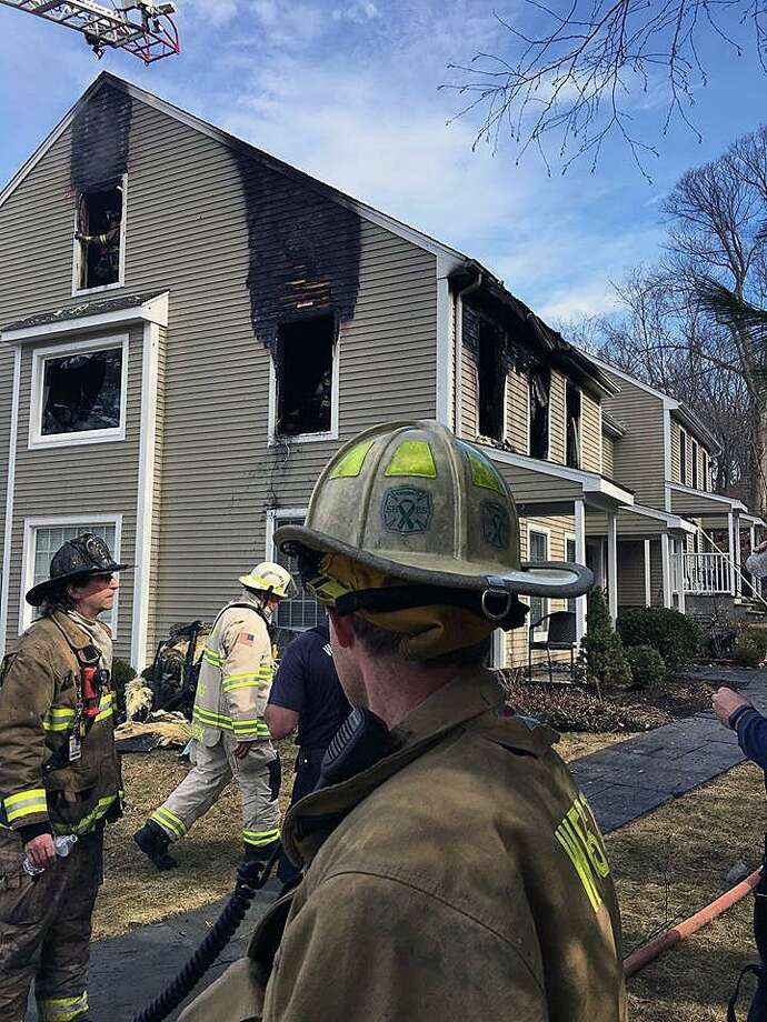 Crews from the Georgetown Volunteer Fire Department were called to 56 Portland Ave. in Georgetown, Conn., around 10 a.m. on Feb. 24, 2018, for a fire that broke out in a second floor condominium. Photo: Contributed Photo / Weston Volunteer Fire Department / Contributed Photo / Connecticut Post Contributed