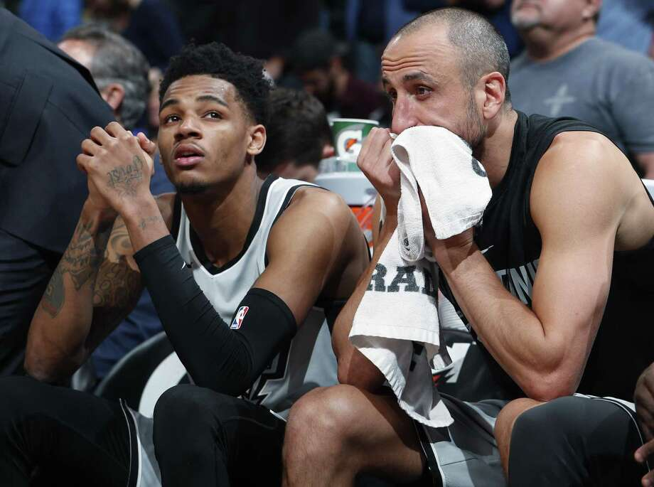 San Antonio Spurs guard Dejounte Murray, left, and guard Manu Ginobili sit on the bench late in the second half of an NBA basketball game against the Denver Nuggets on Friday, Feb. 23, 2018, in Denver. The Nuggets won 122-119. (AP Photo/David Zalubowski) Photo: David Zalubowski, STF / Associated Press / Copyright 2018 The Associated Press. All rights reserved.