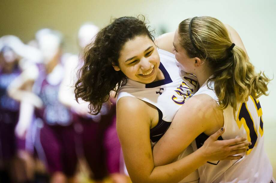 Calvary Baptist senior Tamrah Konieczka, left, hugs senior Savannah Wallace after their 59-50 victory over Lake Orion Baptist in the Michigan Association of Christian Schools championship on Saturday, Feb. 24, 2018 at Springfield Christian Academy in Clarkston. Photo: (Katy Kildee/kkildee@mdn.net)