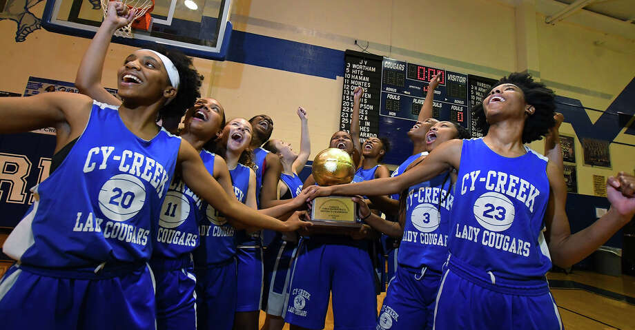The Cy-Creek girls celebrate their winning of the Cypress District basketball Championship L-R Skye George, Dasia Phelps, Sidney Groves, Jamia Griffin, Sadie Bryant, Tanea Sims, Jalyn Johnson, Taylor Jackson, Kyndall Hunter, Kristine Ezimako (not pictured) Rori Harmon Photo: Tony Gaines/ HCN/HCN