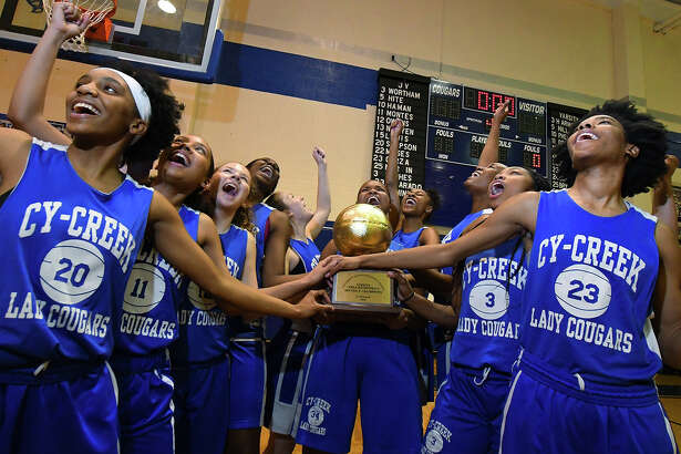 The Cy-Creek girls celebrate their winning of the Cypress District basketball Championship L-R Skye George, Dasia Phelps, Sidney Groves, Jamia Griffin, Sadie Bryant, Tanea Sims, Jalyn Johnson, Taylor Jackson, Kyndall Hunter, Kristine Ezimako (not pictured) Rori Harmon