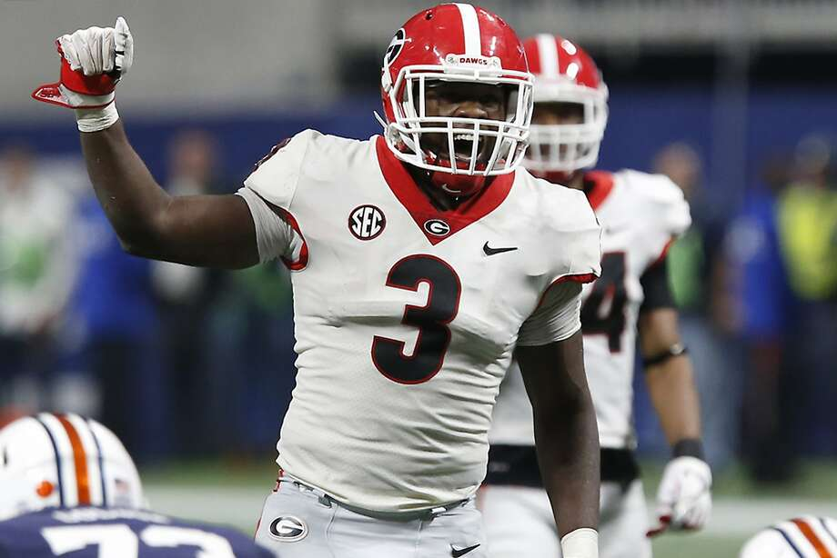 FILE - In this Dec. 2, 2017, file photo, Georgia linebacker Roquan Smith (3) yells out commands before Auburn runs a play during the second half during an NCAA college football game for the Southeastern Conference championship, in Atlanta. Smith was selected to the AP All-Conference SEC team announced Monday, Dec. 4, 2017. (Joshua L. Jones/Athens Banner-Herald via AP, File) Photo: Joshua L. Jones / Associated Press