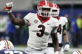 FILE - In this Dec. 2, 2017, file photo, Georgia linebacker Roquan Smith (3) yells out commands before Auburn runs a play during the second half during an NCAA college football game for the Southeastern Conference championship, in Atlanta. Smith was selected to the AP All-Conference SEC team announced Monday, Dec. 4, 2017. (Joshua L. Jones/Athens Banner-Herald via AP, File)