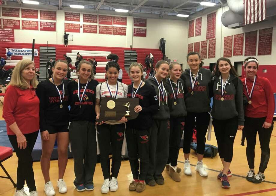 The Greenwich High School gymnastics team won the CIAC Class L championship for the third straight year on Saturday at Pomperaug High School. Photo: Contributed Photo
