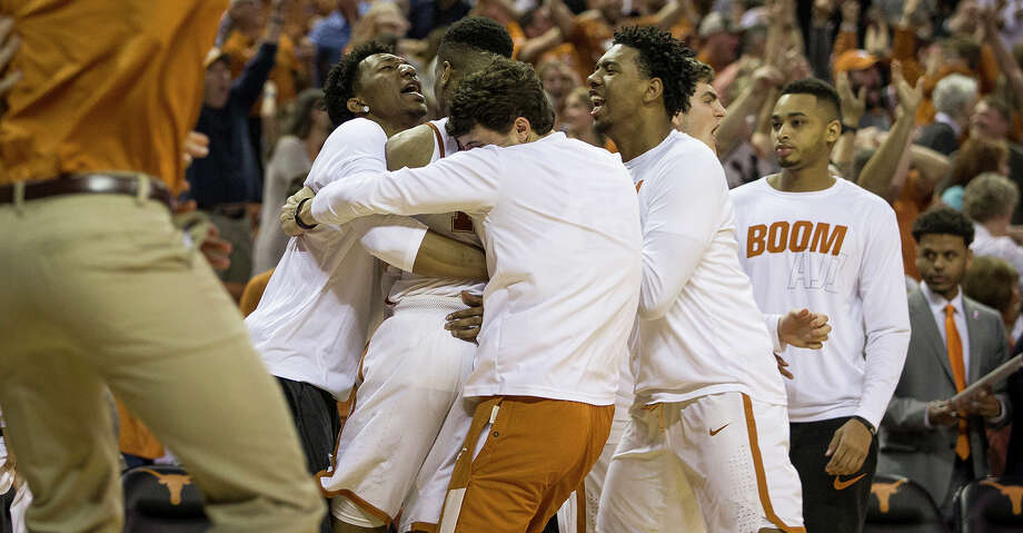 Texas players celebrate with guard Kerwin Roach II (12) after Roach II made the game-winning shot to defeat Oklahoma State 65-64 in an NCAA college basketball game in Austin, Texas, on Saturday, Feb. 24, 2018. (Nick Wagner /Austin American-Statesman via AP) Photo: Nick Wagner/Associated Press