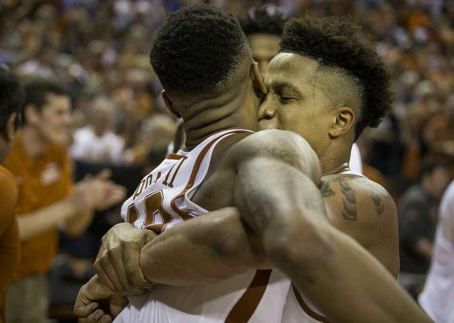 Texas guard Jacob Young (right) hugs guard Kerwin Roach II after Roach made the game-winning shot. Photo: Nick Wagner /Associated Press / Austin American-Statesman