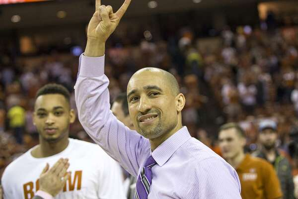 Texas head coach Shaka Smart signals to the crowd after defeating Oklahoma State 65-64 in an NCAA college basketball game in Austin, Texas, on Saturday, Feb. 24, 2018. (Nick Wagner /Austin American-Statesman via AP)