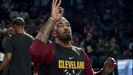 Cleveland Cavaliers guard JR Smith gestures during player introductions before an NBA basketball game against the Memphis Grizzlies Friday, Feb. 23, 2018, in Memphis, Tenn. (AP Photo/Brandon Dill)