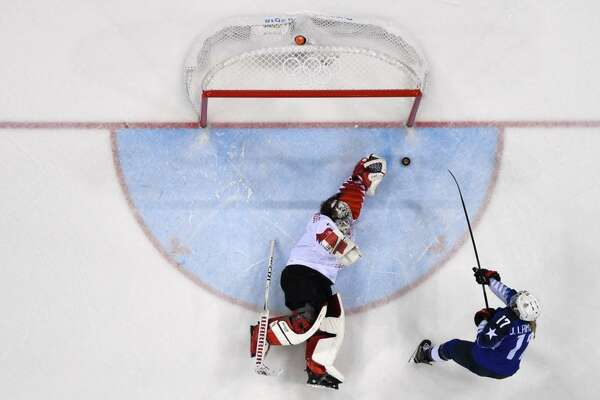 Jocelyne Lamoureux-Davidson scores past Canada's Shannon Szabados during the shootout in the women's gold medal hockey match Thursday in Gangneung, South Korea.