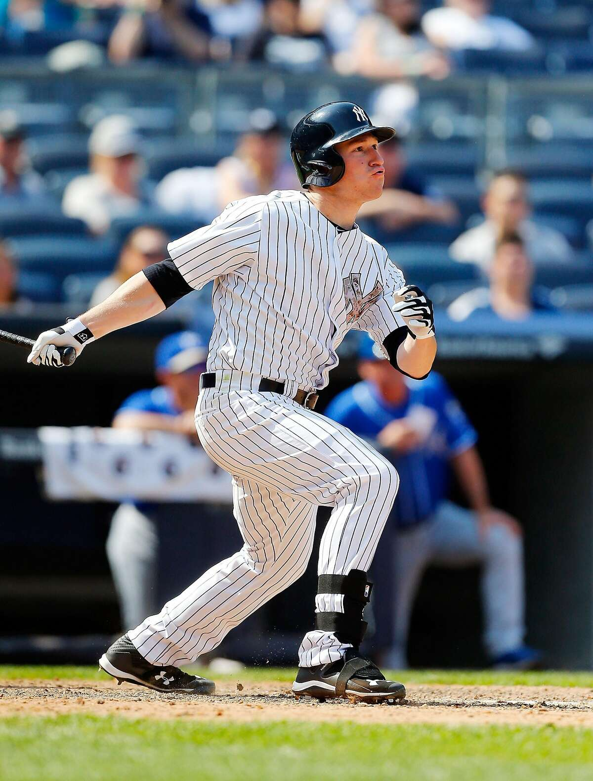 NEW YORK, NY - MAY 25: Slade Heathcott #55 of the New York Yankees follows through on a seventh inning two run home run against the Kansas City Royals at Yankee Stadium on May 25, 2015 in the Bronx borough of New York City. The home run was the first in the major leagues for Heathcott. (Photo by Jim McIsaac/Getty Images)