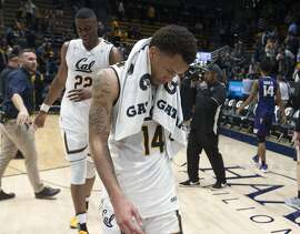 California's Kingsley Okoroh (22) and Don Coleman (14) walk off the court following their 68-51 loss to Washington in an NCAA college basketball game, Saturday, Feb. 24, 2018, in Berkeley, Calif. (AP Photo/D. Ross Cameron)