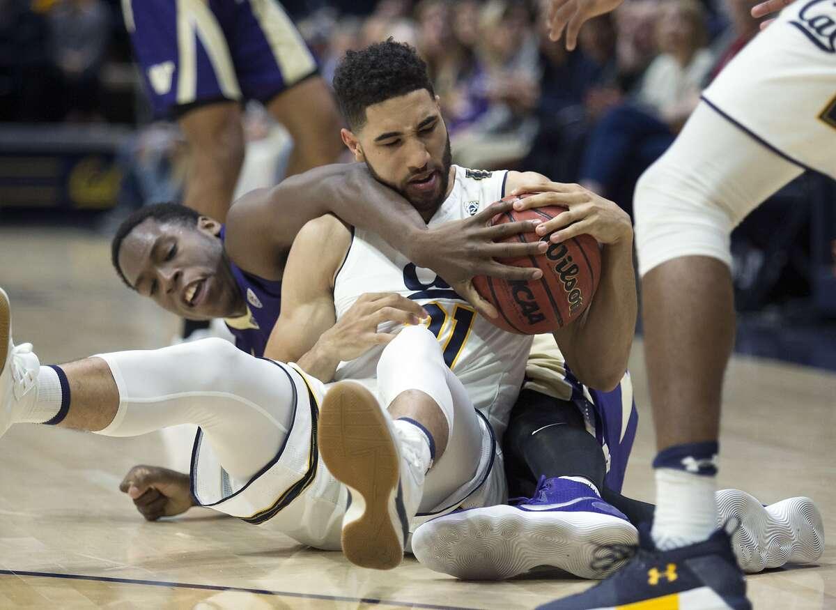 Washington's Noah Dickerson, left, and California's Nick Hamilton (21) battle for a loose ball during the second half of an NCAA college basketball game, Saturday, Feb. 24, 2018, in Berkeley, Calif. Washington won 68-51.