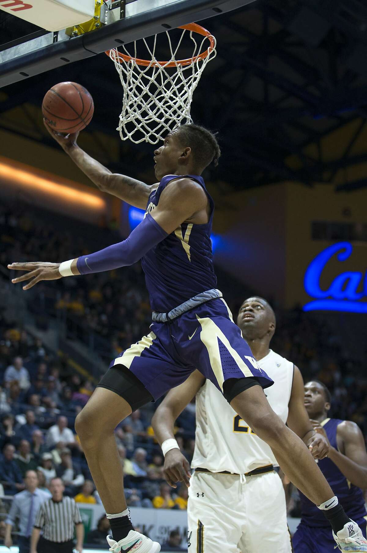 Washington's Hameir Wright, top right, shoots a reverse layup in front of California's Kingsley Okoroh (22) during the second half of an NCAA college basketball game, Saturday, Feb. 24, 2018, in Berkeley, Calif.