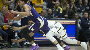 Washington's Matisse Thybulle, front, grabs the ball away from California's Nick Hamilton during the first half of an NCAA college basketball game, Saturday, Feb. 24, 2018, in Berkeley, Calif. (AP Photo/D. Ross Cameron)
