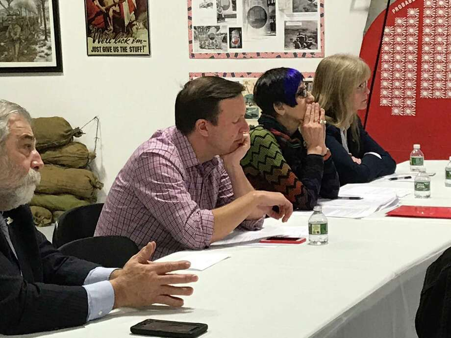 U.S. Sen. Chris Murphy, D-Conn., (shown at center), U.S. Rep. Rose DeLauro, D-3, and West Haven Mayor Nancy Rossi listen to veterans' health care concerns Saturday during a forum at the West Haven Veterans Museum. Photo: Luther Turmelle / Hearst Connecticut Media
