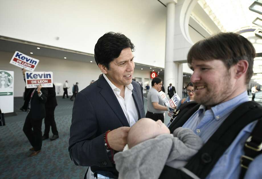 U.S. Senate Candidate and Senator from the State of California Kevin de Leon, D-Los Angeles, Center, speaks with a supporter at the State Convention of the California Democrats 2018, Saturday, February 24, 2018, in San Diego. Photo: Denis Poroy, Associated Press