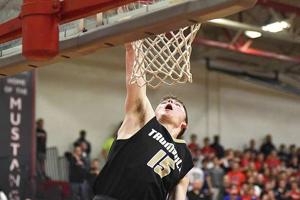 Trumbull's Chris Brown sends down a dunk to the finishing touches on Trumbull's win over Fairfield Warde in an FCIAC boys basketball quarterfinal at the Fairfield Warde gymnasium on Saturday.