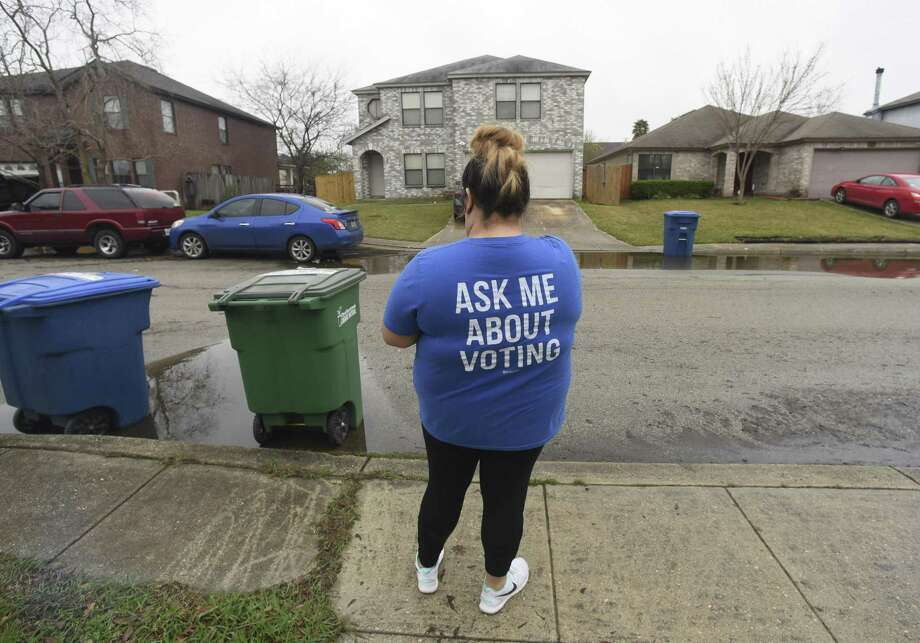 Destiny Molina, regional organizer for Congressional District 23, walks a West San Antonio neighborhood on Saturday, Feb. 24, 2018. She knocked on many doors, hoping to get potential voters to commit to voting Democrat. Photo: Billy Calzada, Staff / San Antonio Express-News / San Antonio Express-News