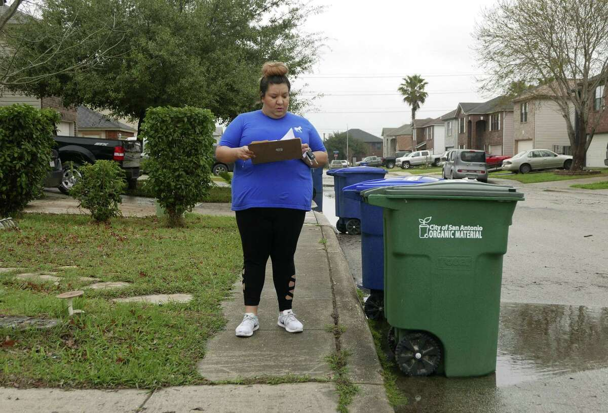 Destiny Molina, regional organizer for Congressional District 23, walks a West San Antonio neighborhood on Saturday, Feb. 24, 2018. She knocked on many doors, hoping to get potential voters to commit to voting Democrat.