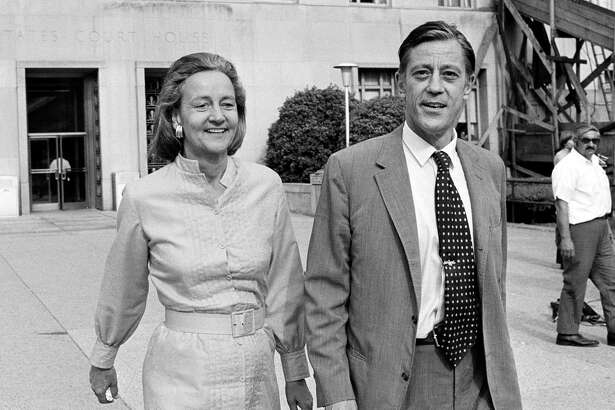 """FILE - In this June 21, 1971 file photo, Katharine Graham, left, publisher of The Washington Post, and Ben Bradlee, executive editor of The Washington Post, leave U.S. District Court in Washington after getting the go-ahead to print the Pentagon papers on Vietnam. Later, the U.S. Court of Appeals extended the ban against publishing the secret documents for one day. Graham and Bradlee are portrayed by Meryl Streep and Tom Hanks in the Oscar nominated film """"The Post,"""" which deals with the publishing of the Pentagon papers. (AP Photo, File)"""