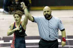 Mack Beggs of Euless Trinity defeated Chelsea Sanchez of Morton Ranch to defend his Class 6A girls 110-pound title during the UIL State Wrestling Championships at the Berry Center, Saturday, Feb. 24, 2018, in Cypress.