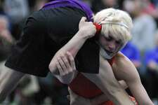 Danbury's Ryan Jack wrestles Westhill's Chase Parrot during the finals of the State Open, held Saturday in New Haven.