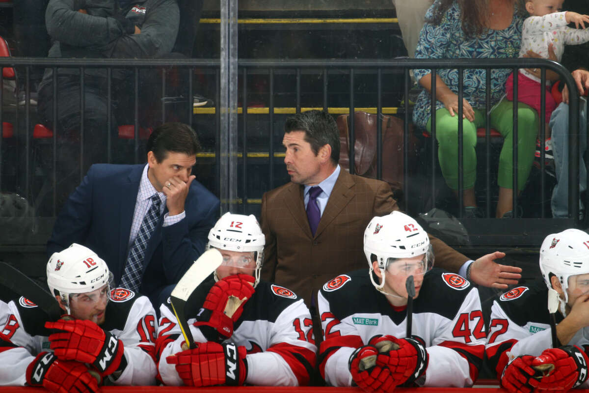 Head coach Rick Kowalsky, left, talks with assistant coach Sergei Brylin behind the Binghamton Devils bench. (JustSports Photography / Binghamton Devils)