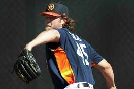 Houston Astros RHP pitcher Gerrit Cole (45) throws a bullpen session during spring training at The Ballpark of the Palm Beaches, Saturday, Feb. 17, 2018, in West Palm Beach.   ( Karen Warren / Houston Chronicle )