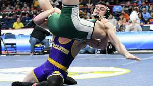 Tyler Barnes of Ballston Spa, bottom, lifts Grant Cuomo of Brewster in the Division I 170 class state wrestling final during the NYSPHSAA Wrestling Championships on Saturday, Feb. 24, 2018, at the Times Union Center in Albany, N.Y. (Will Waldron/Times Union)