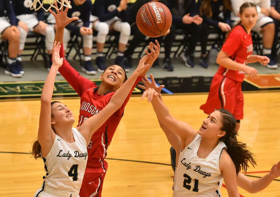 Judson's Heaven Mbaruk foghts for a rebound with Laredo Alexander's Katelyn De La Cruz (4) and Sheyla Cardenas (21) during their Region IV-6A final at Littleton Gym Satuday afternoon. Photo: Robin Jerstad, Freelance / ROBERT JERSTAD
