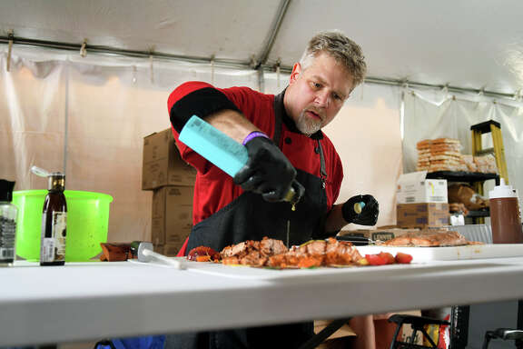 David Welch, of Kingwood and chef for the Fire Craft BBQ team sponsored by Waste Management, prepares his Backyard Smoked Salmon BBQ during day one of the Houston Livestock Show and Rodeo World's Championship Bar-B-Que Contest at NRG Park on Feb. 22, 2018. (Photo by Jerry Baker/Freelance)