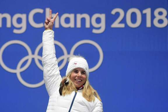 Czech Republic's Ester Ledecka celebrates on the podium after winning gold in the snowboard women's parallel giant slalom, her second gold in an unlikely combination of events.