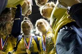 Cypress Ranch wrestlers share a moment after winning the Class 6A girls team title during the UIL State Wrestling Championships at the Berry Center, Saturday, Feb. 24, 2018, in Cypress.