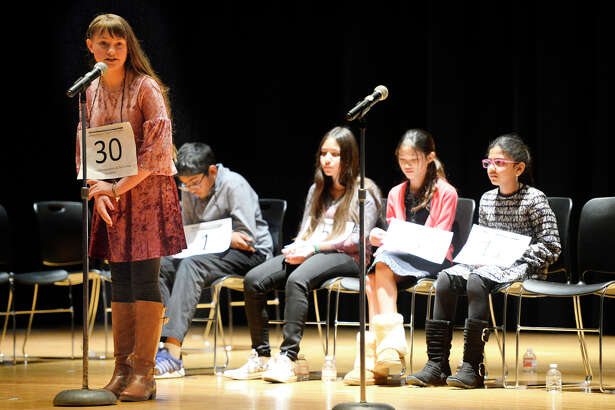 Pease Communications and Technology Academy's Vivian Myers competes in the 31st annual Midland Reporter-Telegram Regional Spelling Bee Feb. 24, 2018 at the Allison Fine Arts building on the campus of Midland College. James Durbin/Reporter-Telegram