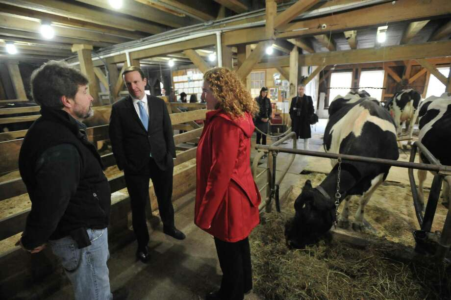 U.S. Sen. Chris Murphy and Rep. Elizabeth Esty, D-Connecticut, visited Thorncrest Farm & Milk House Chocolates in Goshen Friday. Above, Murphy and Esty speak with farm owner Clint Thorn. Photo: Ben Lambert / Hearst Connecticut Media /