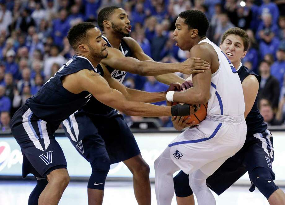 Creighton's Ty-Shon Alexander, second from right, fights with Villanova's Phil Booth, left, and Mikal Bridges for ball control. Photo: Nati Harnik, STF / Copyright 2018 The Associated Press. All rights reserved.