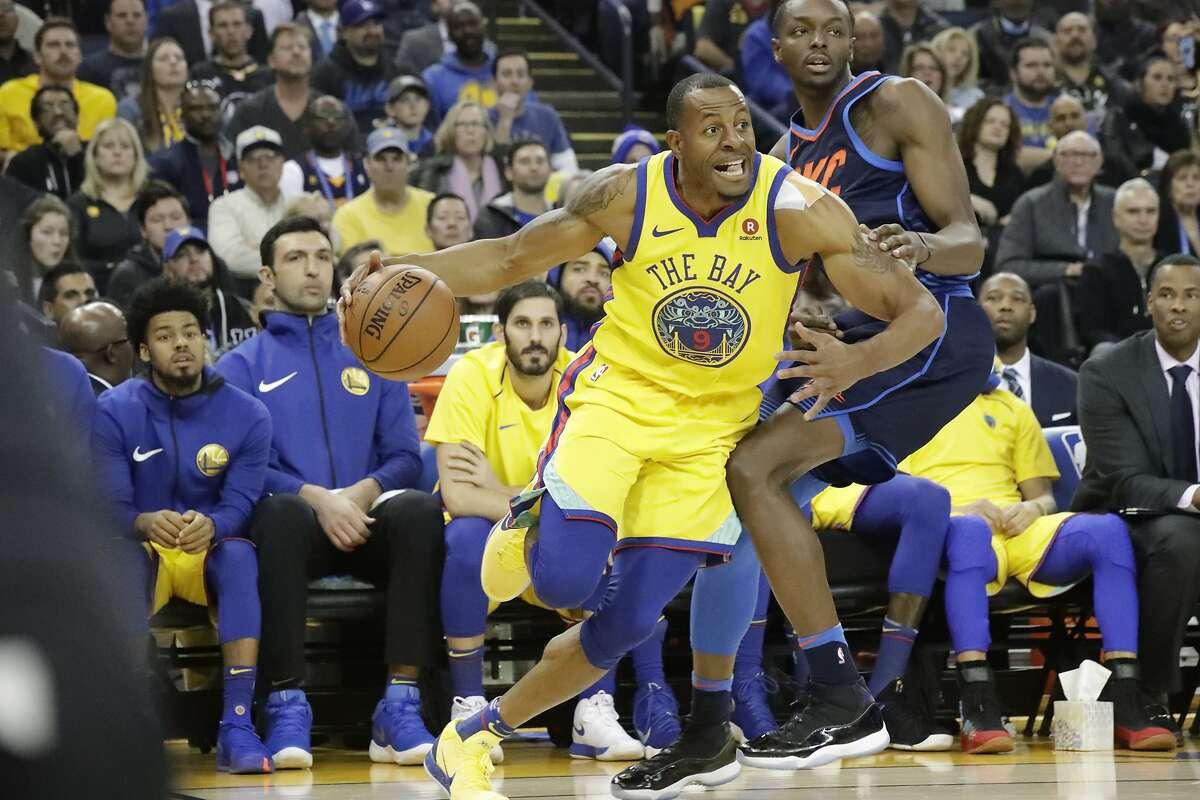 Golden State Warriors forward Andre Iguodala (9) drives on Oklahoma City Thunder forward Jerami Grant (9) on Saturday, Feb. 24, 2018 in Oakland, CA.