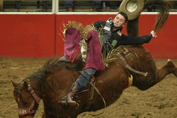 Caleb Bennett hangs on to win the bareback riding competition during the finals of the San Antonio Stock Show & Rodeo in the AT&T Center on Saturday, Feb. 24, 2018.